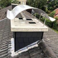 Fertigstellung Kamin: Verkleidung mit schwarzen Faserzementplatten, Beton-Kaminabdeckung & Kaminhaube. (Lübke-Welle, Edelstahl, Dicke = 1,5mm)